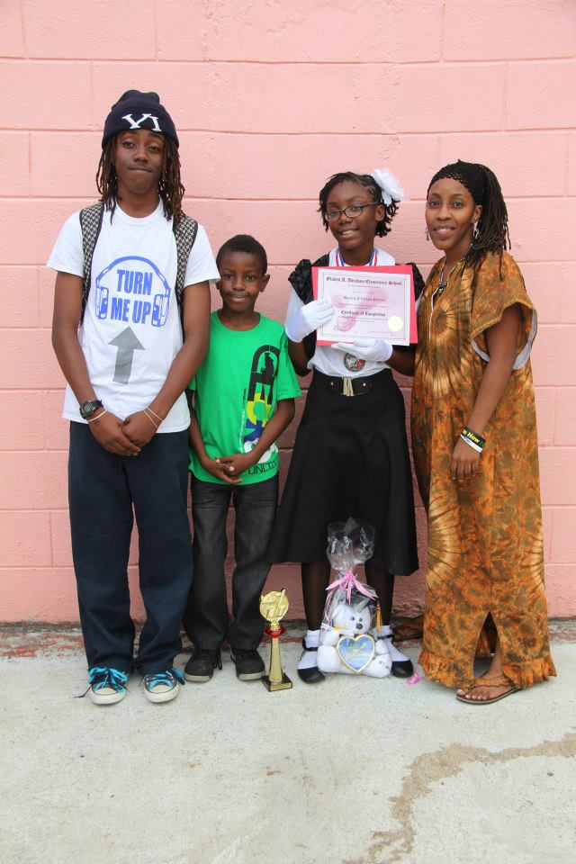 Family Photo at Gladys Abraham Elementary after Majestik's 6th grade Promotion