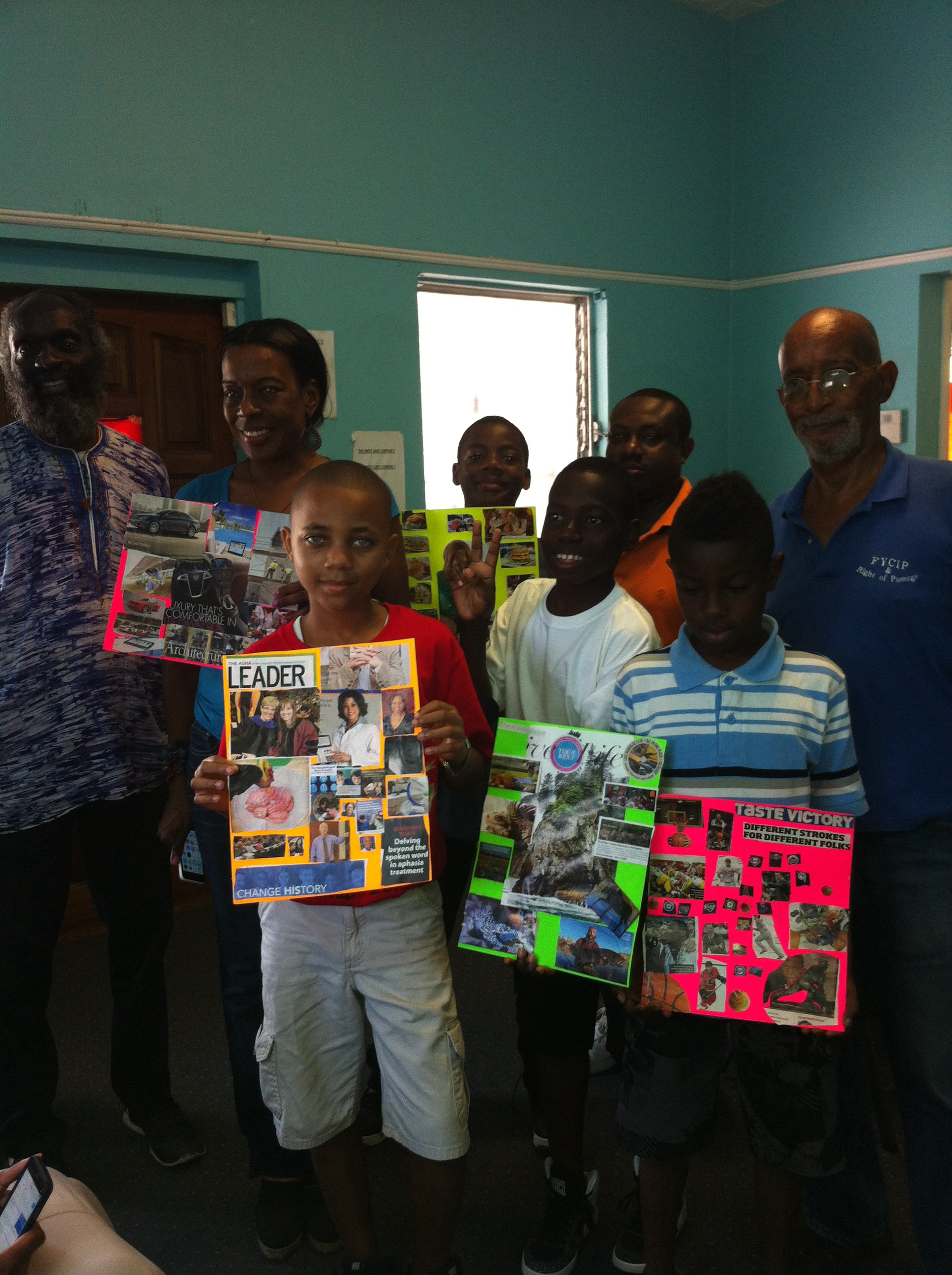Students display their vision boards with their mentors